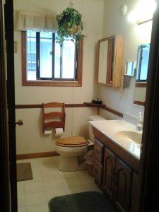 A nice bathroom with a shower!